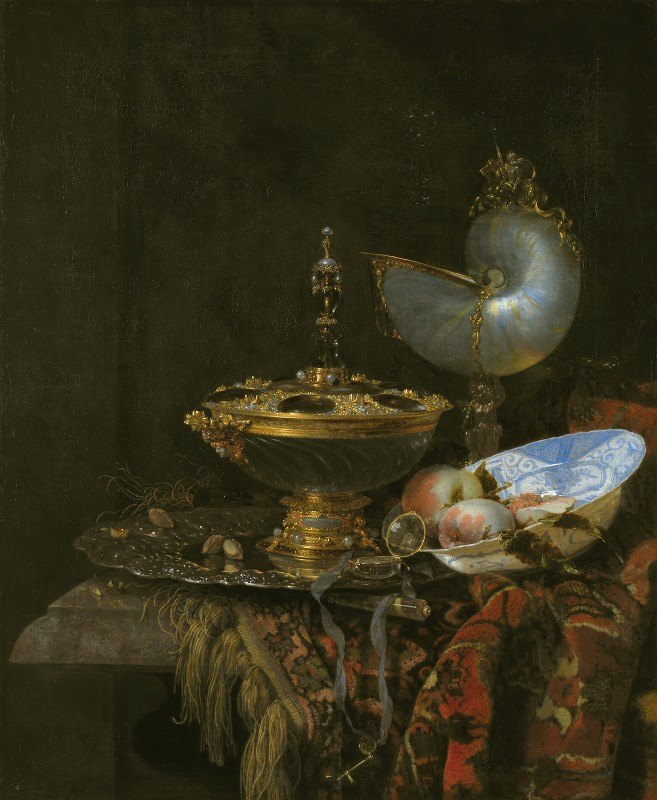 Willem Kalf - Pronk Still Life With Holbein Bowl, Nautilus Cup, Glass Goblet And Fruit Dish