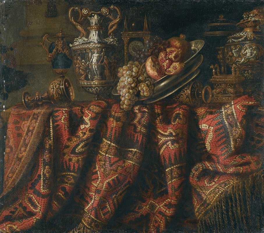 Jacques Hupin - A Still Life With Pomegranates, And Grapes On A Table Draped With An Ornate Turkish Carpet And Assorted Orfèvrerie